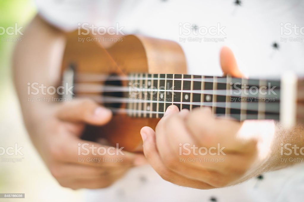 musician playing ukulele guitar stock photo