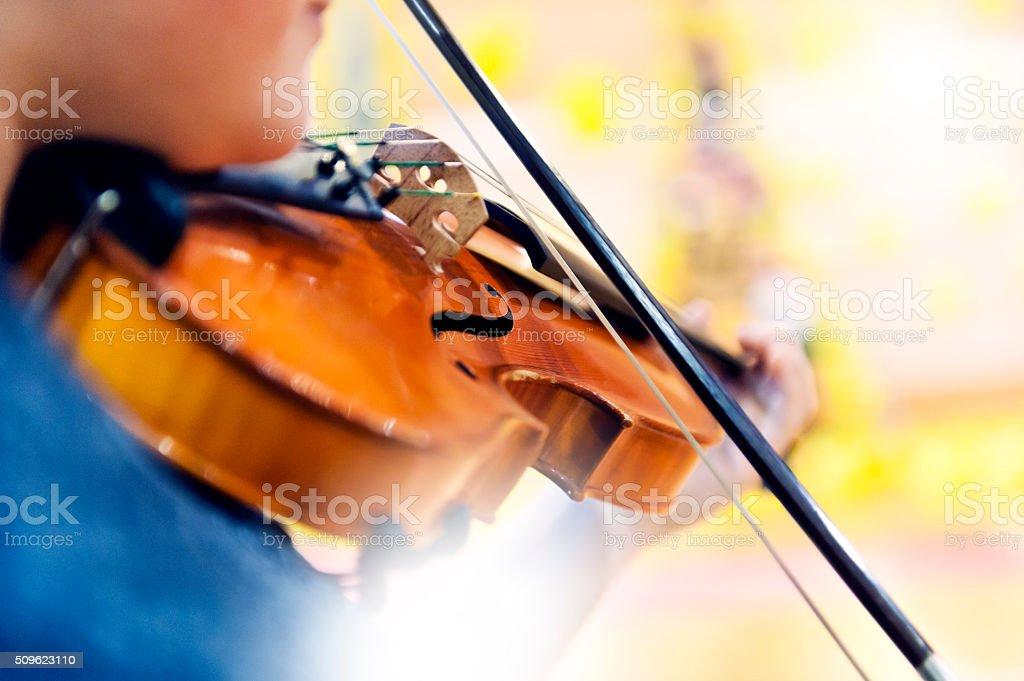Musician playing violin stock photo