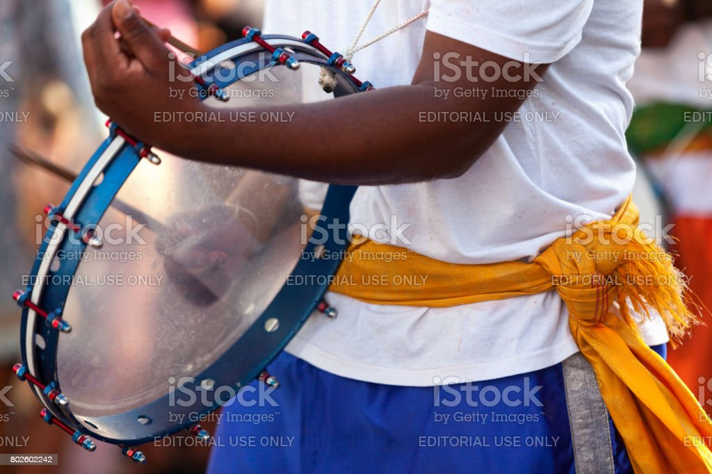 Musician playing with a frame drum stock photo