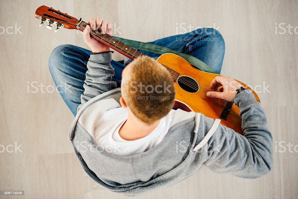Musician plays Acoustic Guitar, Bird-Eyes View stock photo