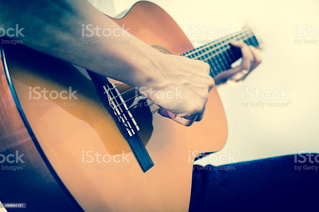Musician plays Acoustic Guitar stock photo