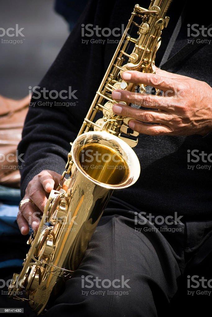 Musician Plays Saxophone Shiny Gold royalty-free stock photo