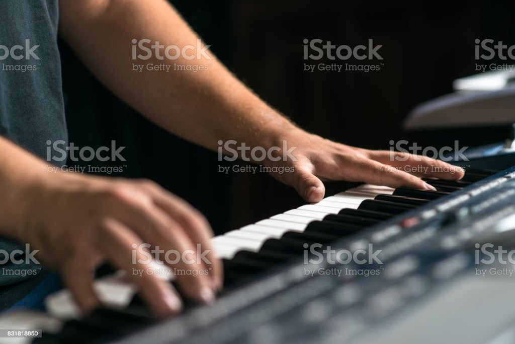 A musician plays the keyboard musical instrument, close-up stock photo