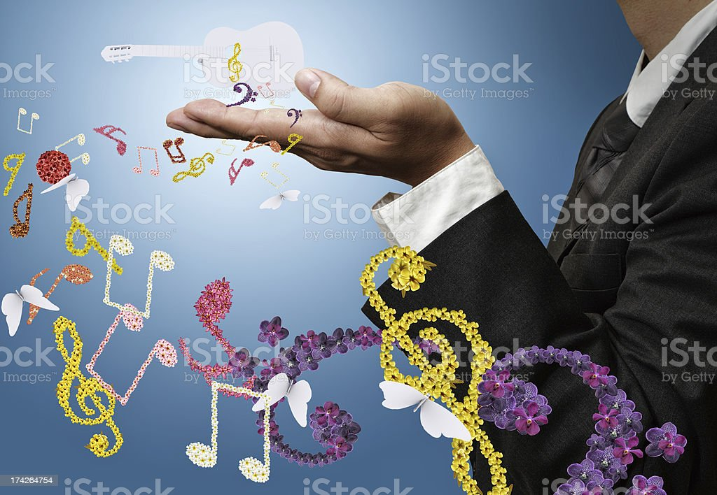 musician shows classical guitar and flower music royalty-free stock photo