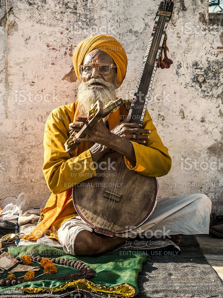 Musician singing and playing music at Udaipur India stock photo