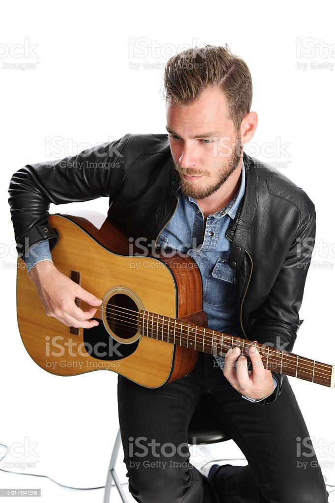 Musician sitting down with guitar stock photo