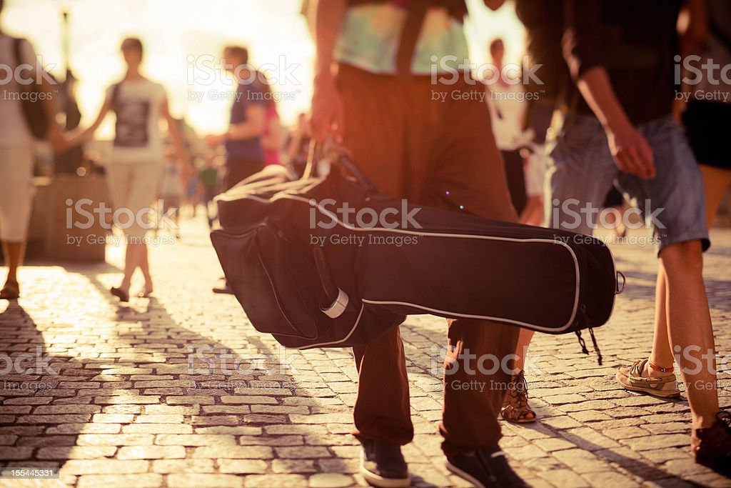 Musician walking on the street stock photo