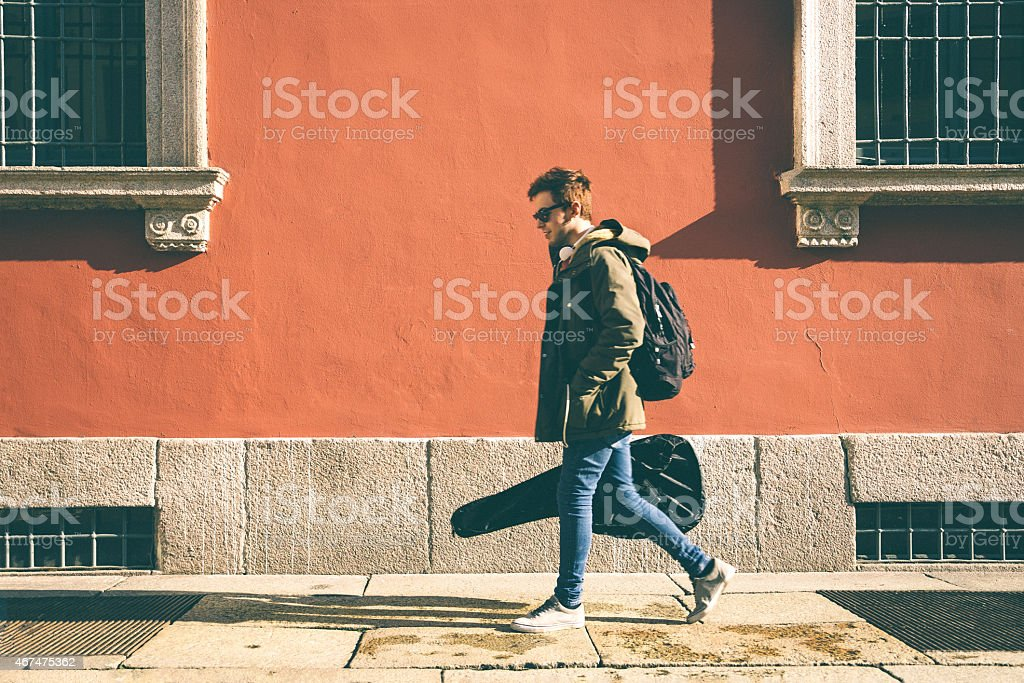 Musician Walking The Street stock photo