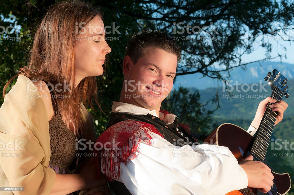 Musician with Giutar Courting Young Woman, ?tanjel, Slovenia stock photo