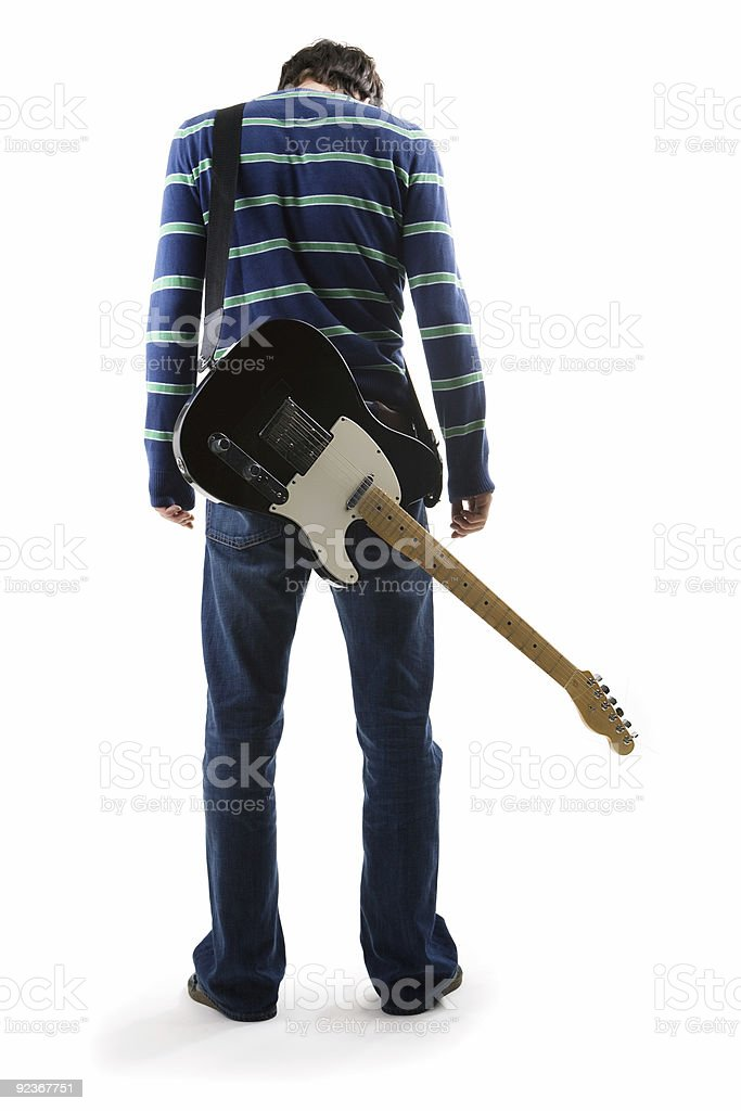 Musician with guitar on his back royalty-free stock photo