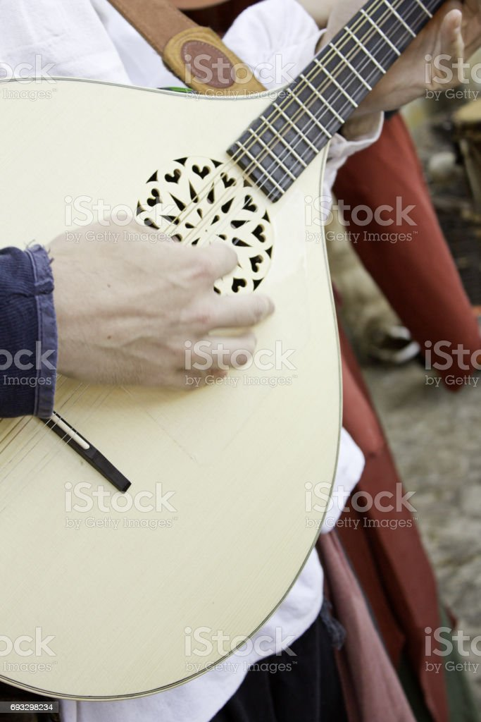 Musician with lute stock photo