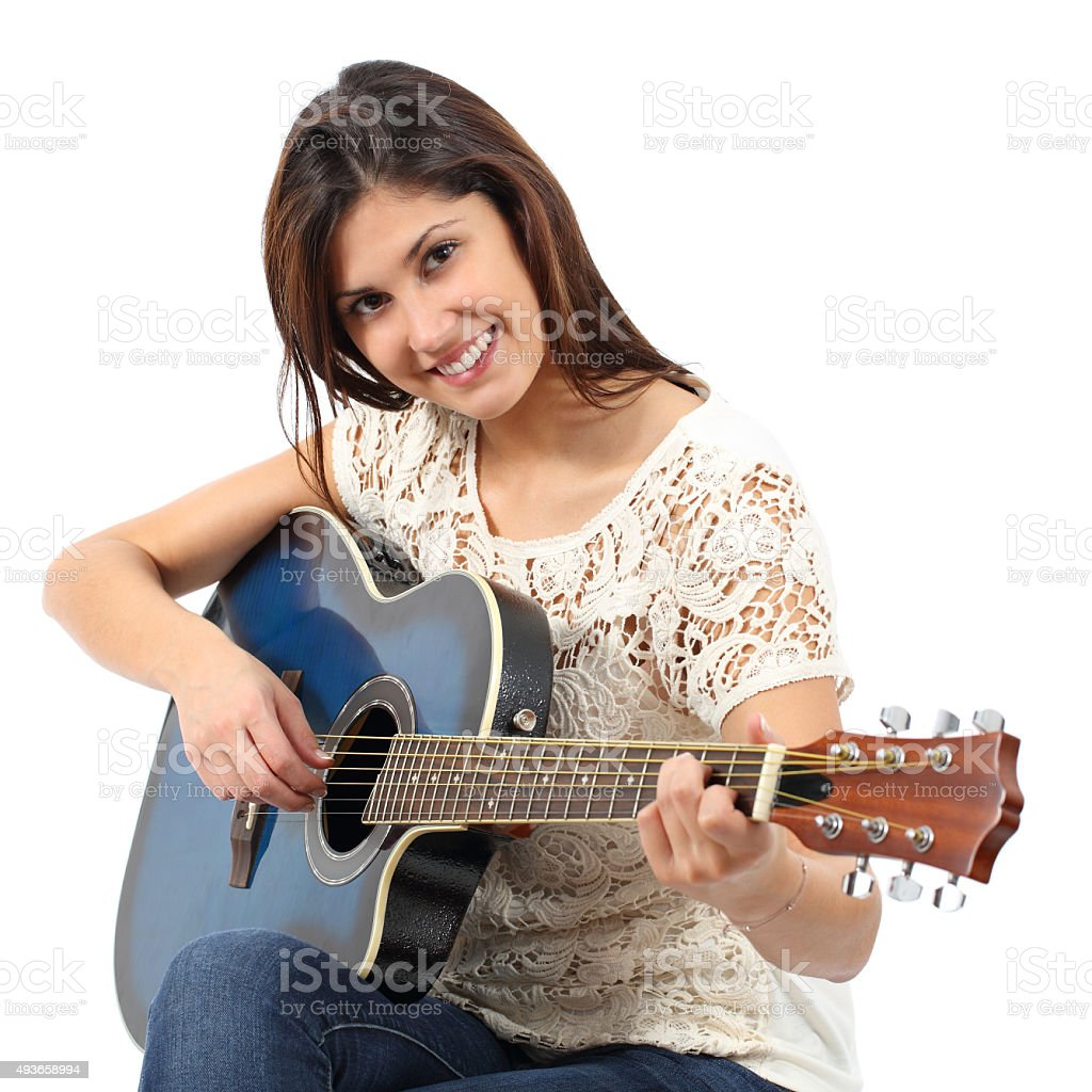 Musician woman playing guitar in a course stock photo