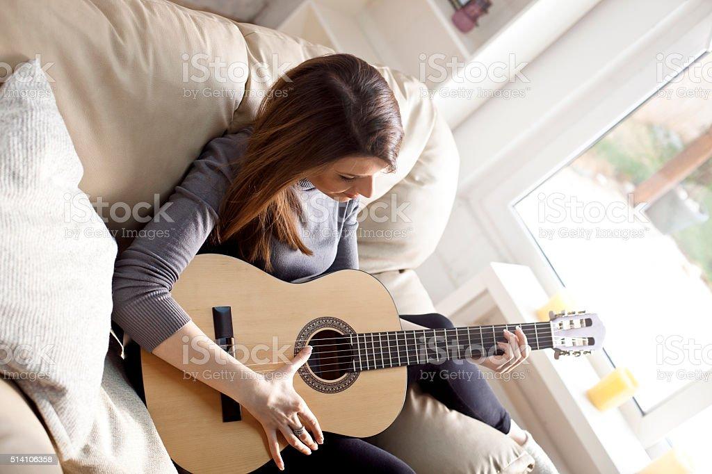 Musician woman playing guitar stock photo