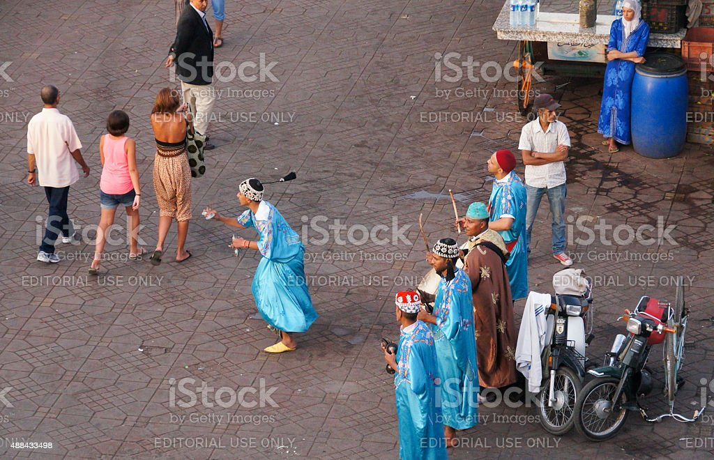 Musicians and dancer working at old town square,Marrakesh. stock photo