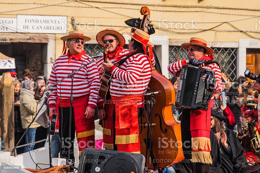 Musicians dressed as gondoliers perform at the Venice Carnival stock photo