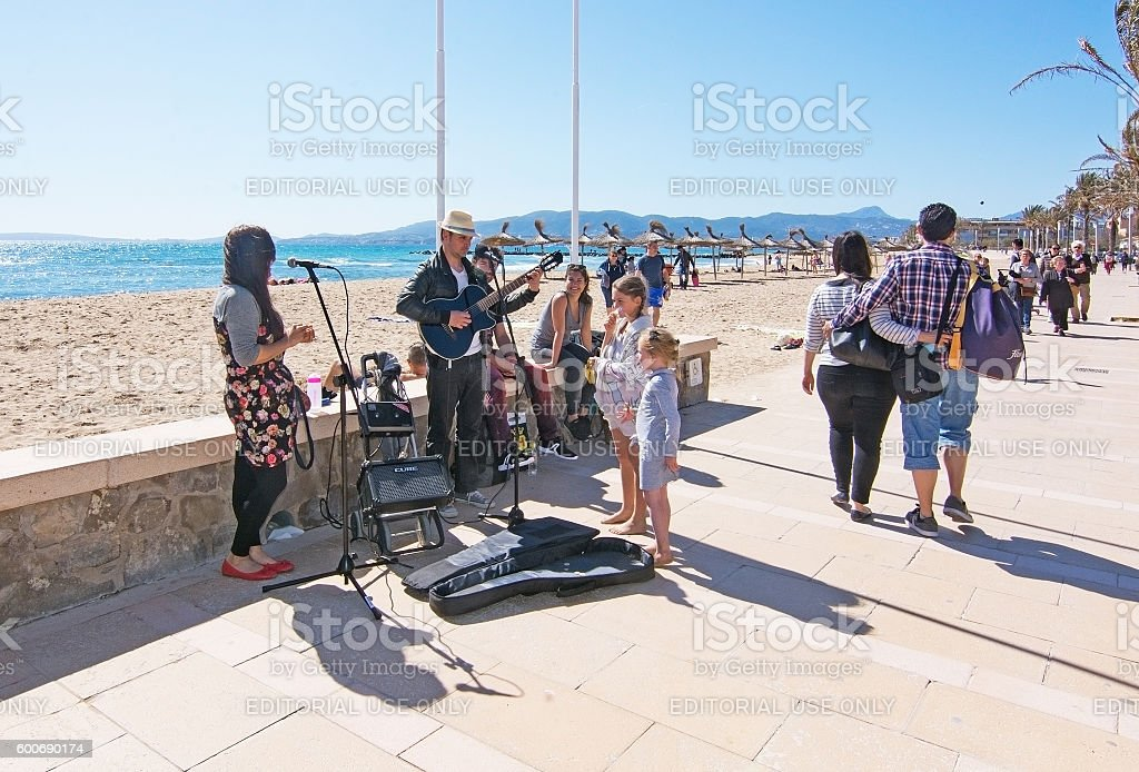 Musicians playing by the beach stock photo