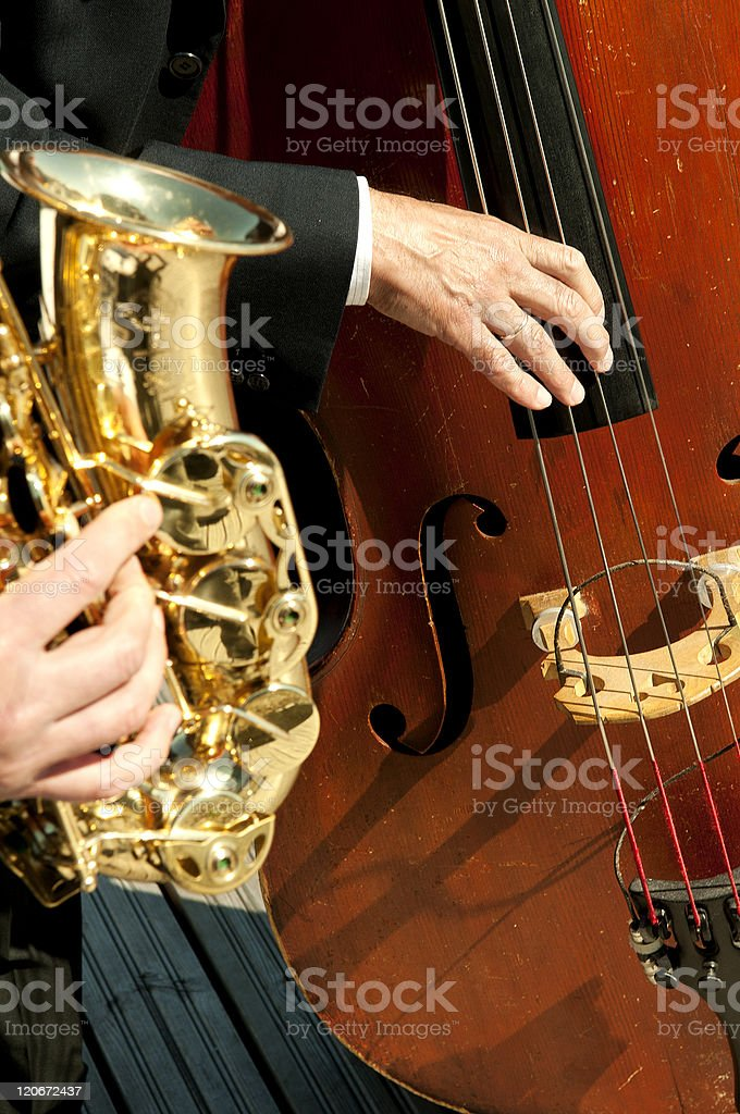 musicians playing instruments in the sun stock photo