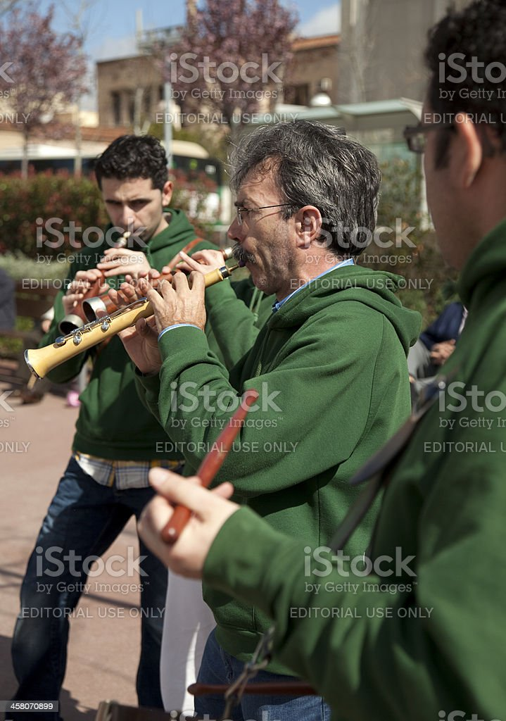 Musicians playing the gralla stock photo