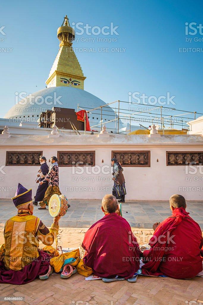 Musicians playing traditional instruments at Boudhanath Buddhist stupa Kathmandu Nepal stock photo