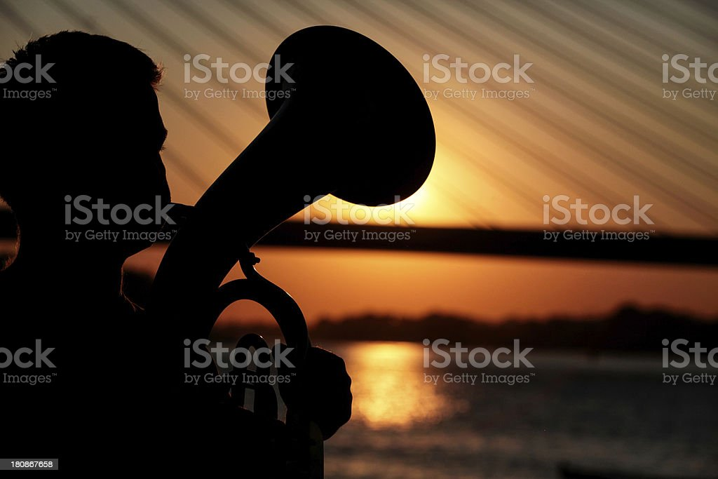 Musicians playing trumphet at sunset royalty-free stock photo