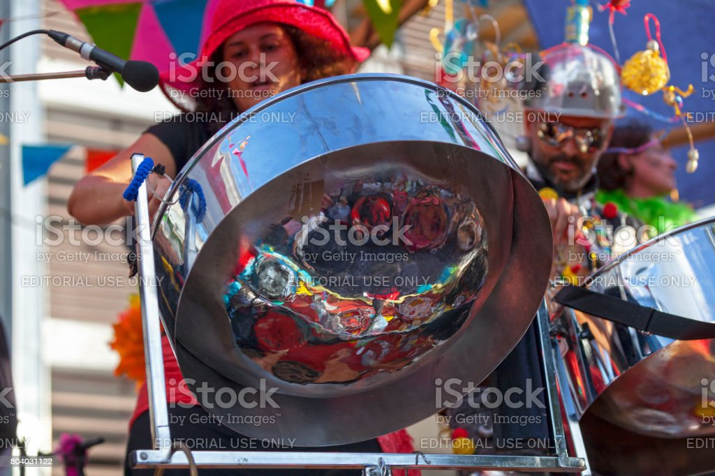 Musicians playing with steel drums stock photo