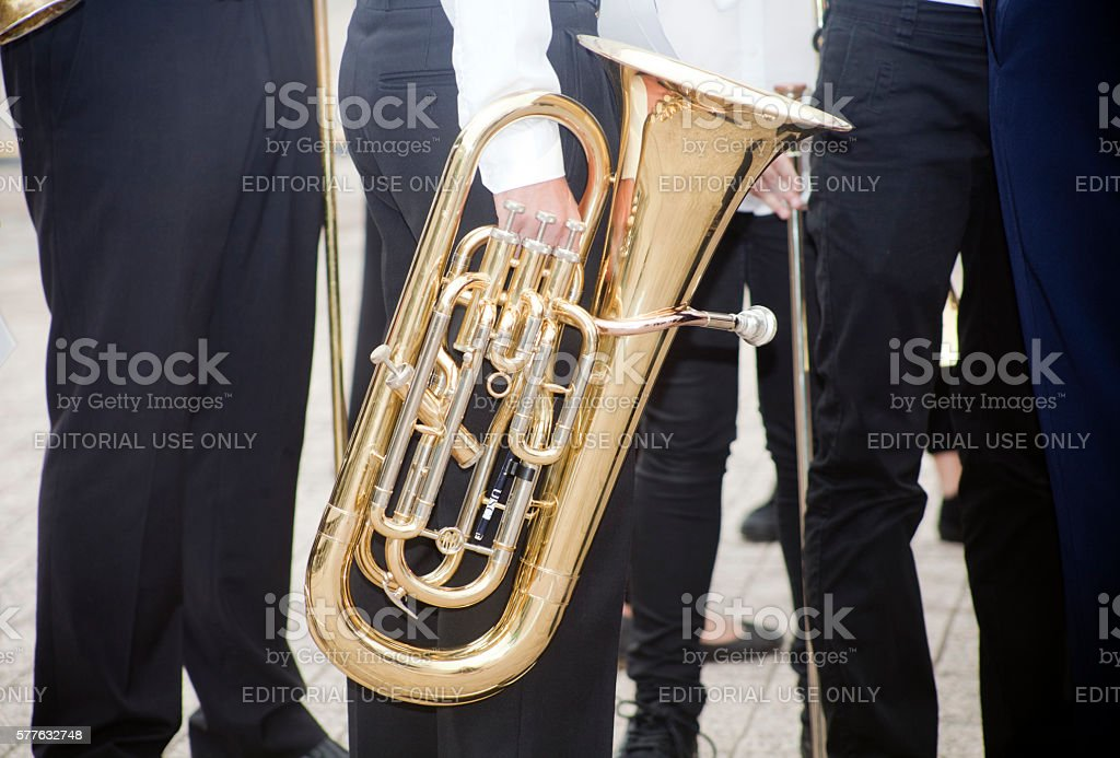 Musicians walking with a tuba. stock photo