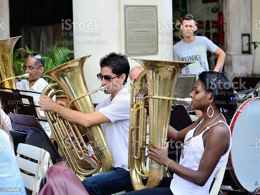 Musicians with a tubes in an orchestra in Havana, Cuba. stock photo