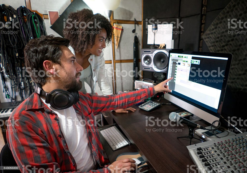 Musicians working at a recording studio stock photo