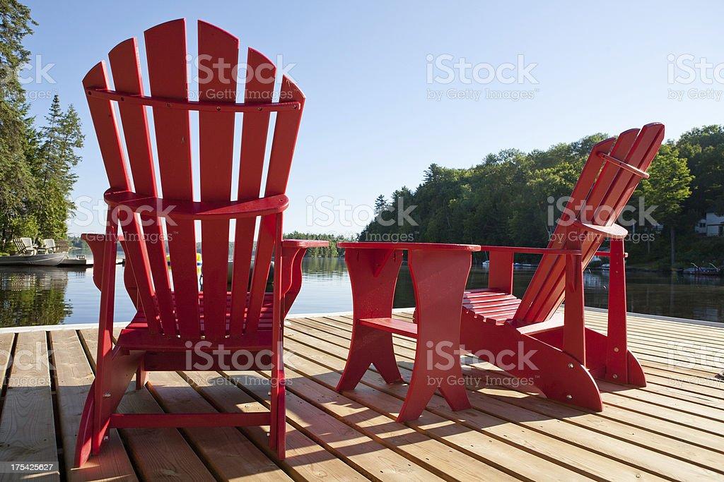 Muskoka Chairs on a Sunny Morning stock photo