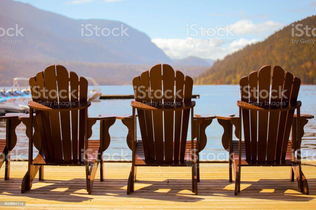 Muskoka chairs on deck - Stock image stock photo