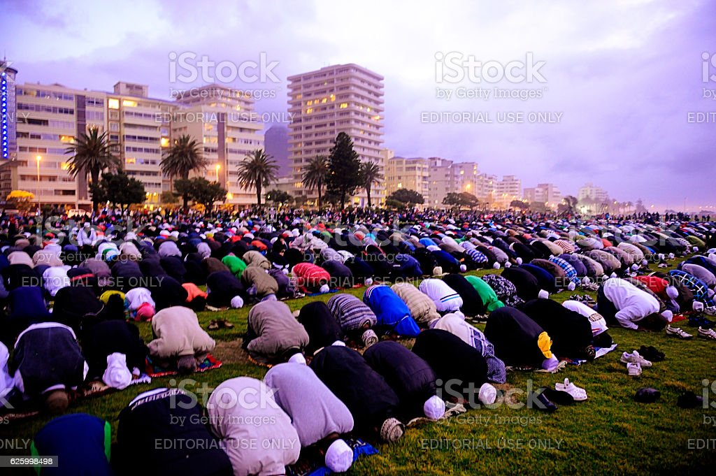 Muslems pray to mark the end of Eid al Fitr stock photo