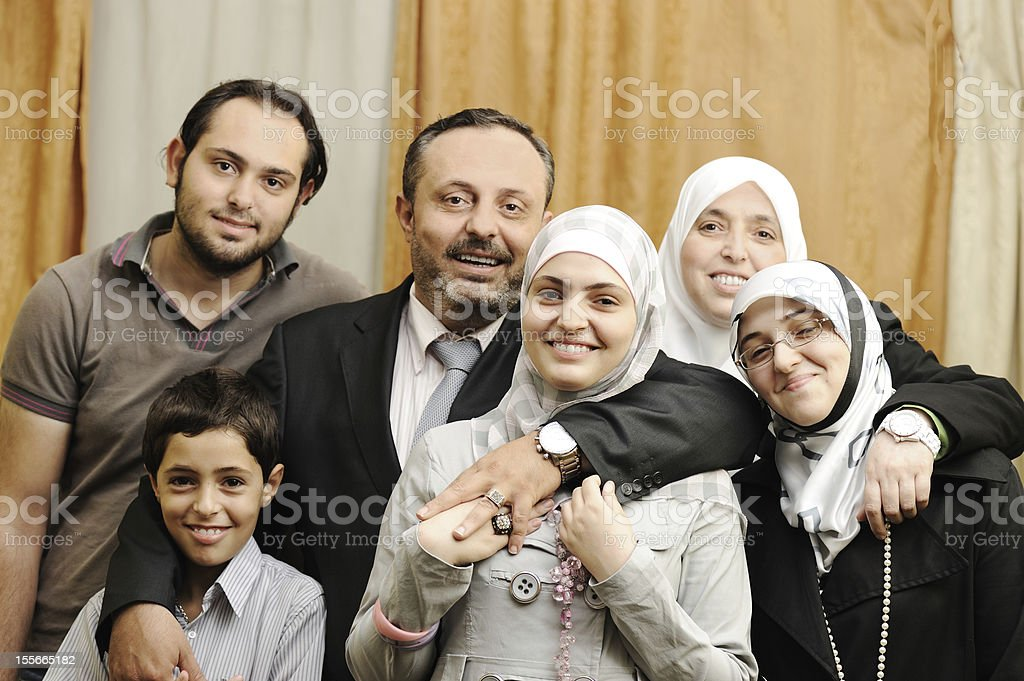 Muslim Arabic family indoor stock photo