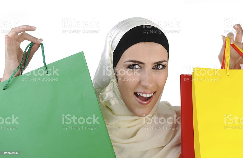 Muslim Arabic woman with shopping bags, cheerful expression stock photo