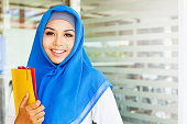 Muslim asian girl, a college student, in a class room