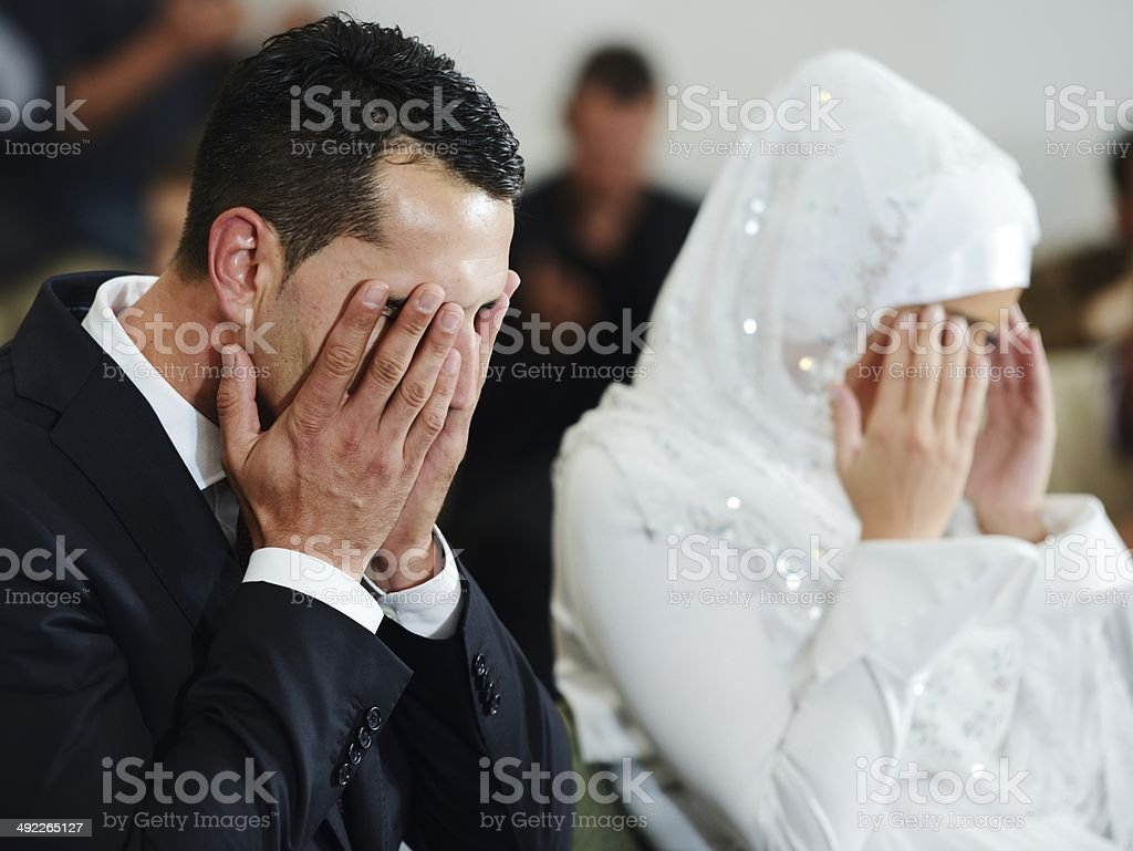 Muslim bride and groom at the mosque stock photo
