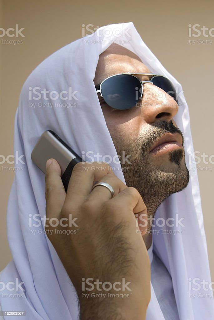 Muslim business man with handphone and sunglasses royalty-free stock photo