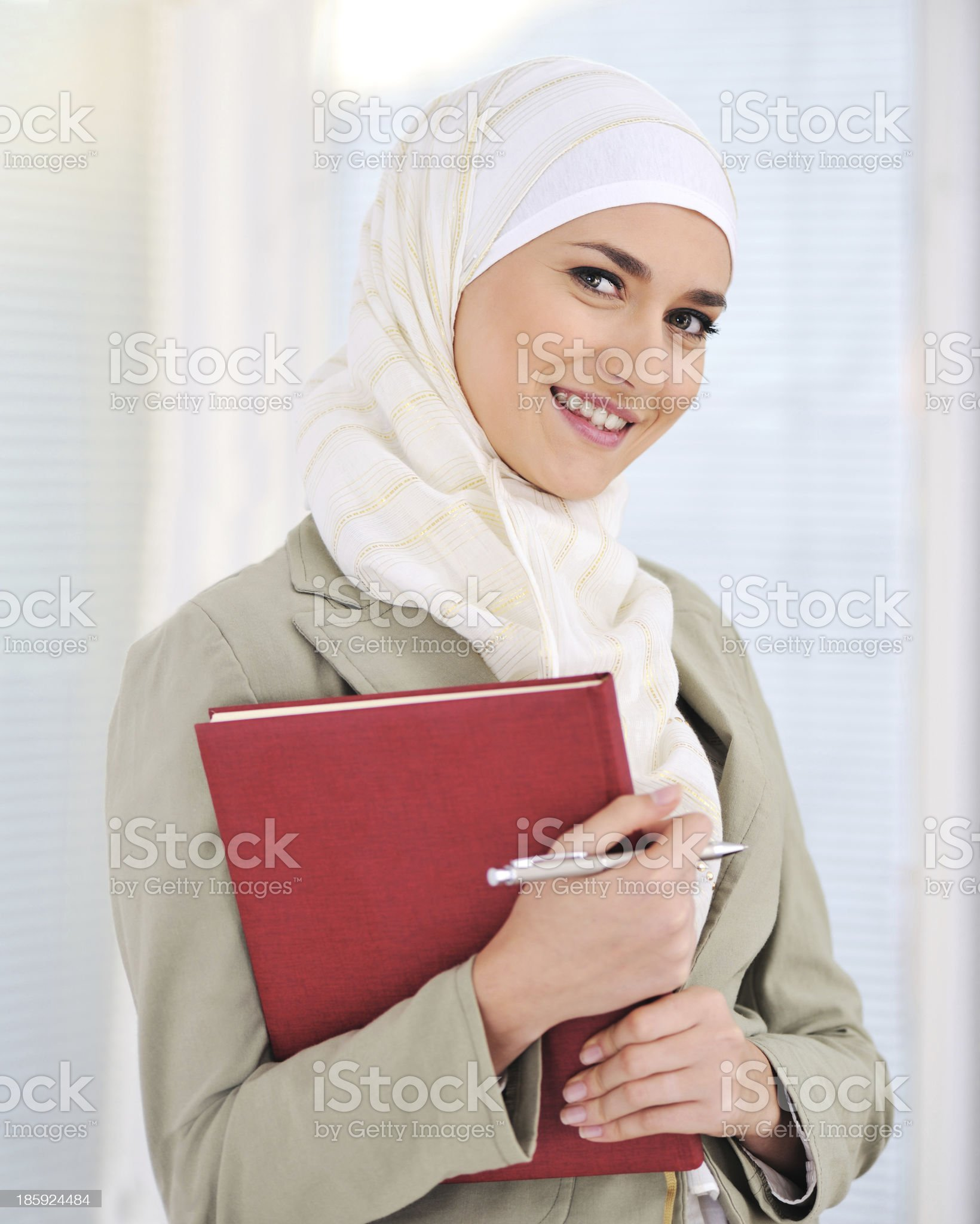 Muslim Caucasian female student with notebook and pen royalty-free stock photo