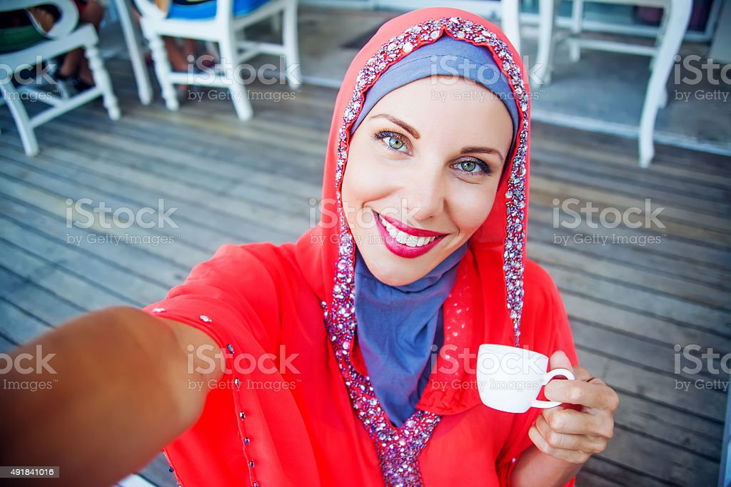 muslim caucasian woman taking selfie stock photo