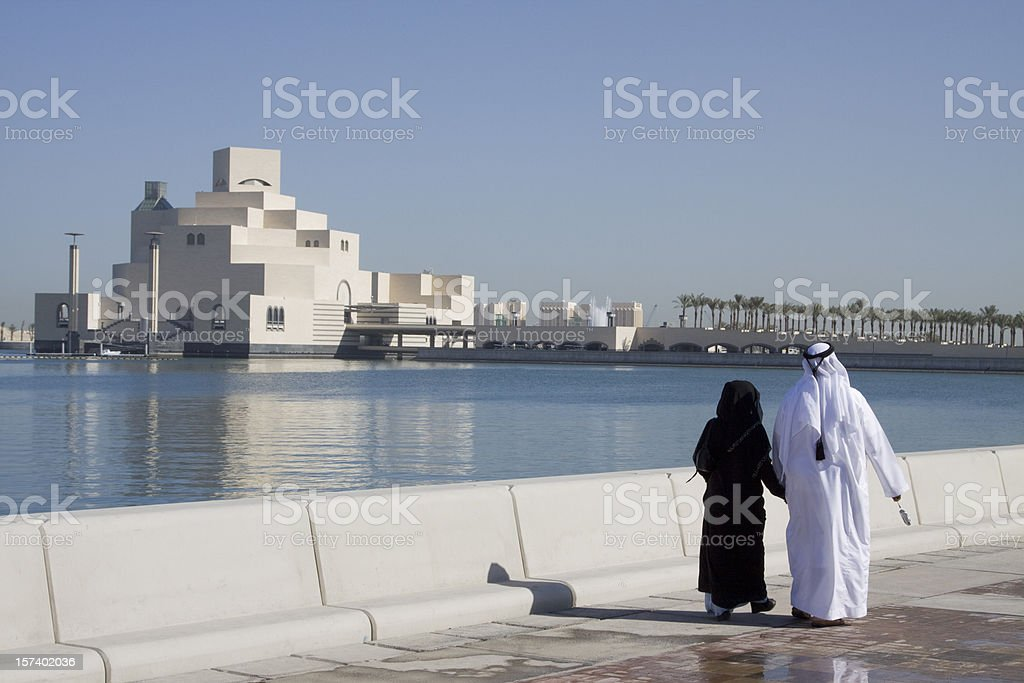 Muslim couple along Doha Corniche stock photo