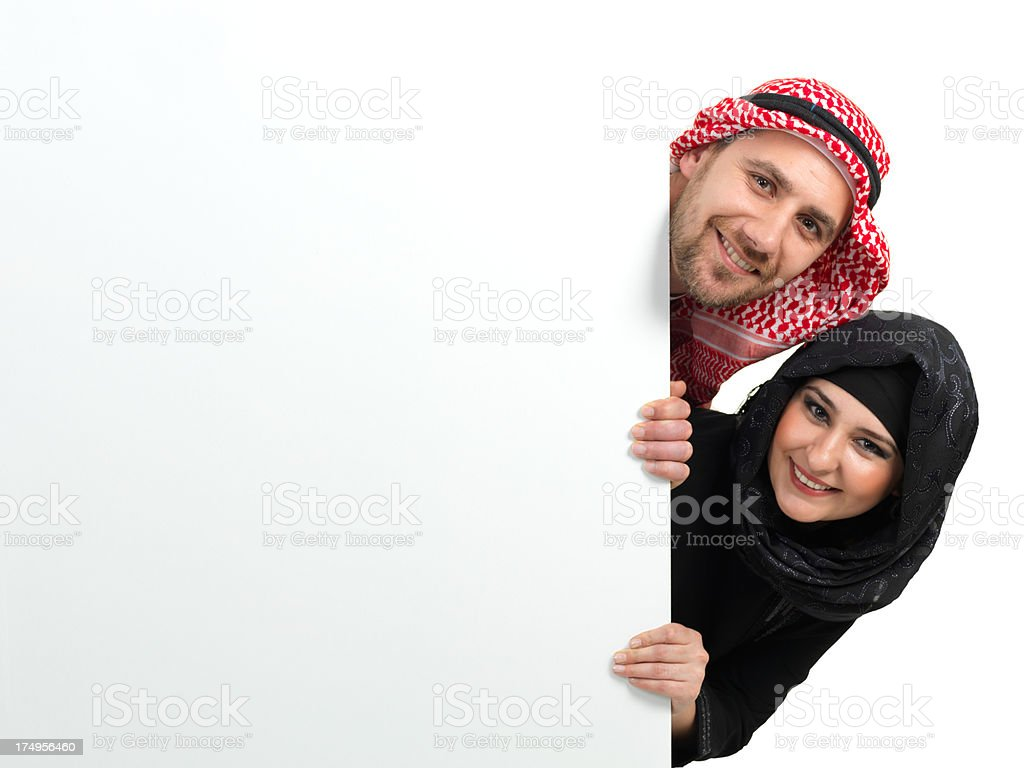 Muslim Couple and Billboard royalty-free stock photo