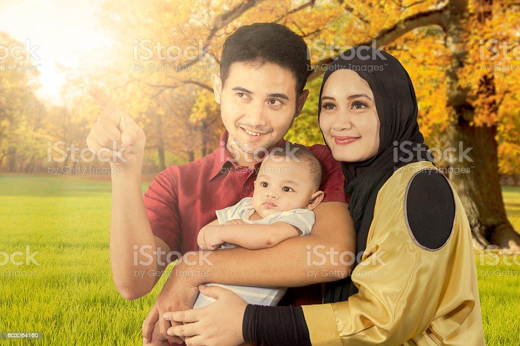 Muslim family at autumn park stock photo