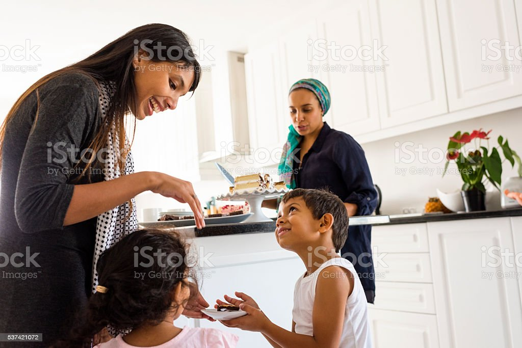 Muslim Family & Friends Enjoying Afternoon Tea stock photo