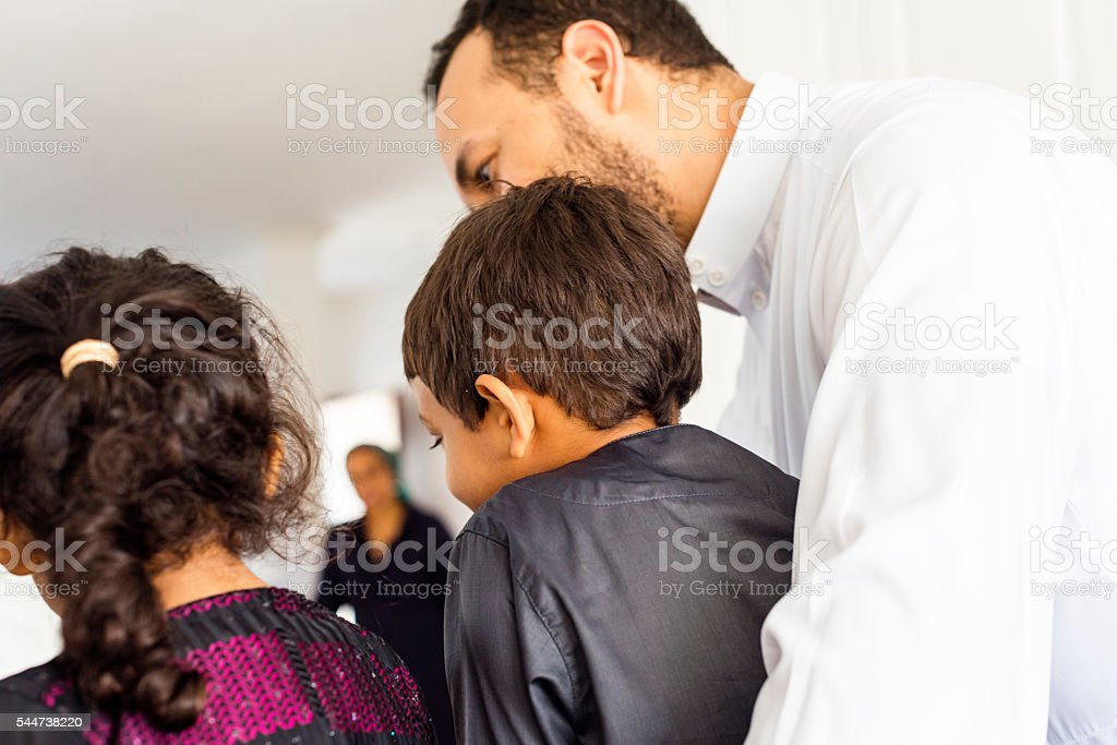 Muslim Family Spending Time Together At Home stock photo