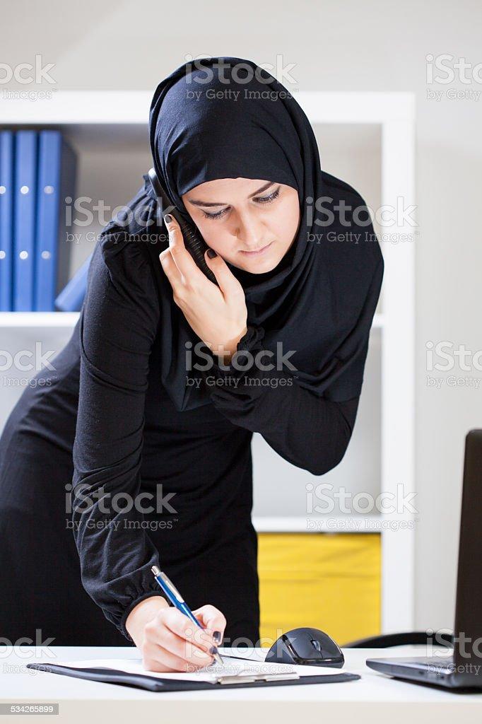 Muslim female at work stock photo
