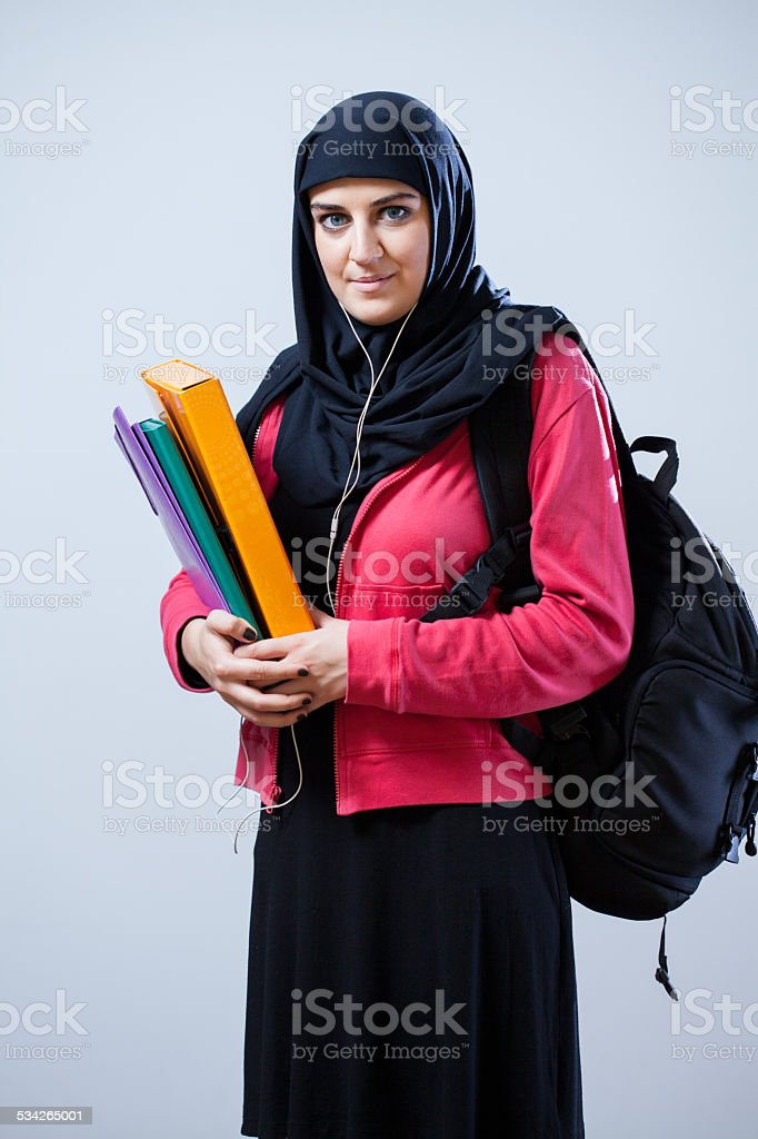 Muslim female student with backpack stock photo