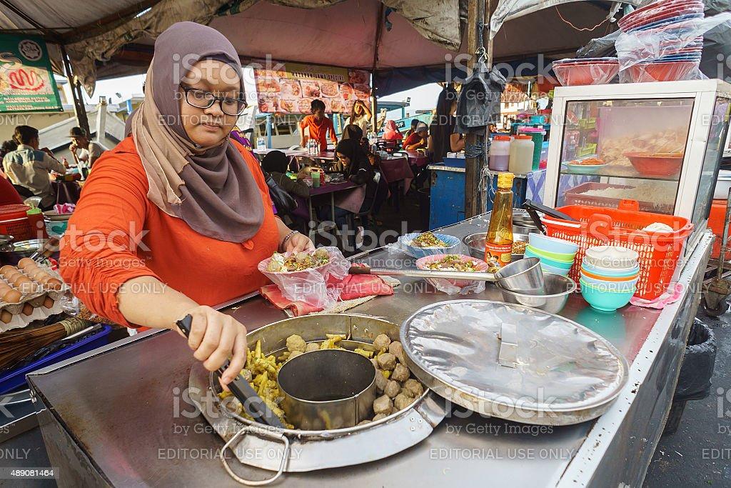 Muslim food seller stock photo