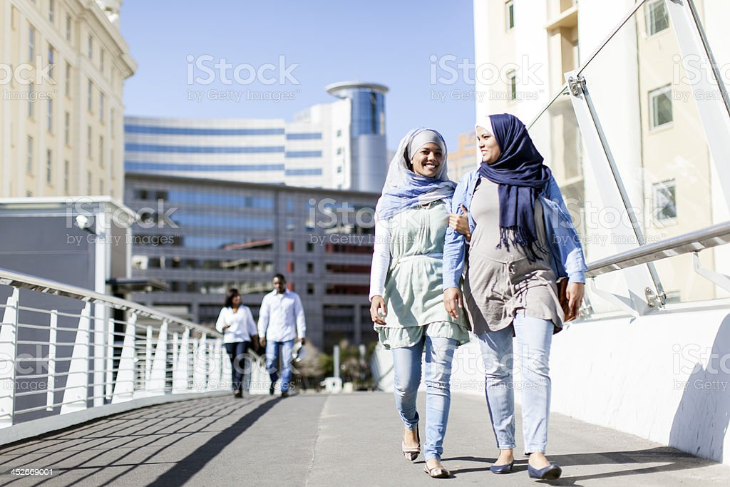 Muslim friends going for a walk in Cape Town. royalty-free stock photo