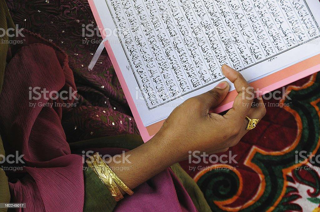 Muslim girl praying at Jama masjid royalty-free stock photo