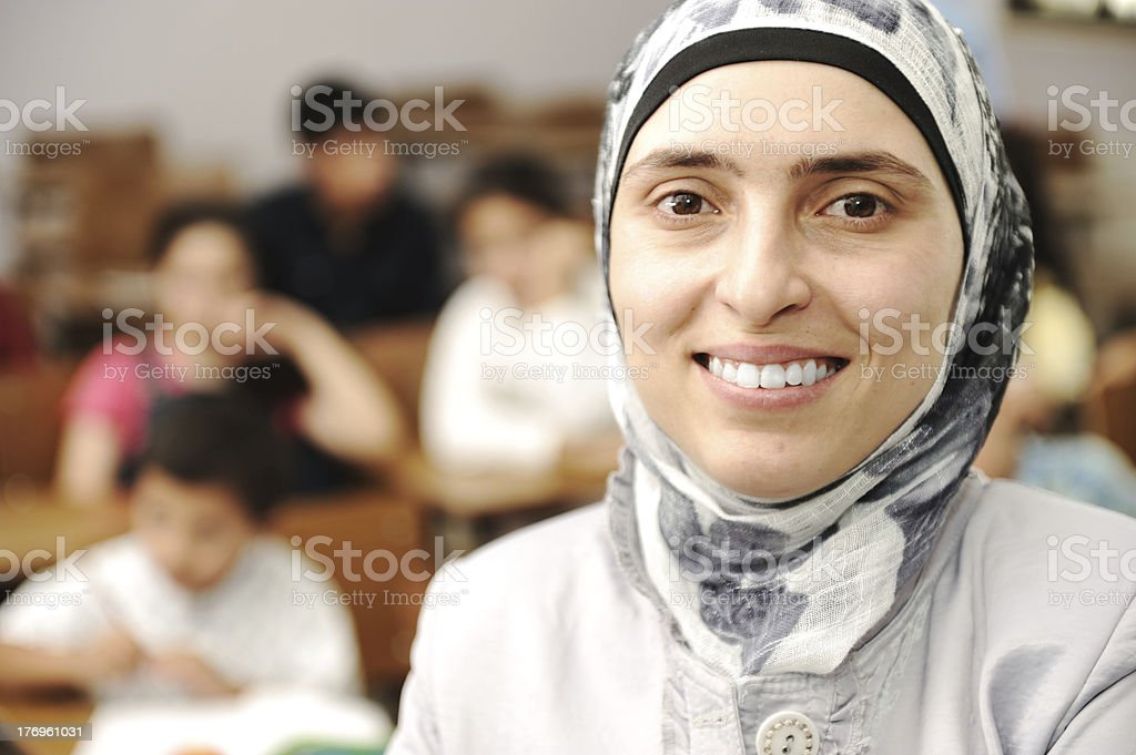 Muslim kids in the school, classroom with a teacher stock photo