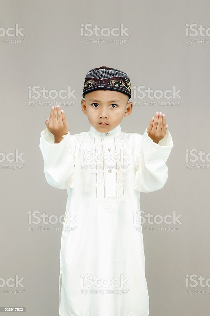 Muslim little kid  pray. stock photo